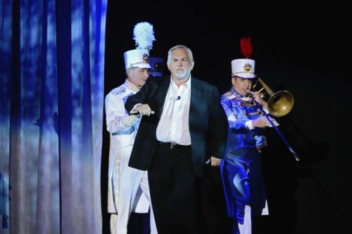 John Ratzenberger walks onstage at D23 with a marching band in celebration of his 14 Pixar film voice roles.