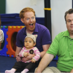 Cam (Eric Stonestreet) and Mitchell (Jesse Tyler Ferguson) with daughter Lily (Aubrey Anderson-Emmons) on Modern Family.
