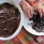 "Preparing Oreo cookies for chocolate pudding graveyard ""dirt"""
