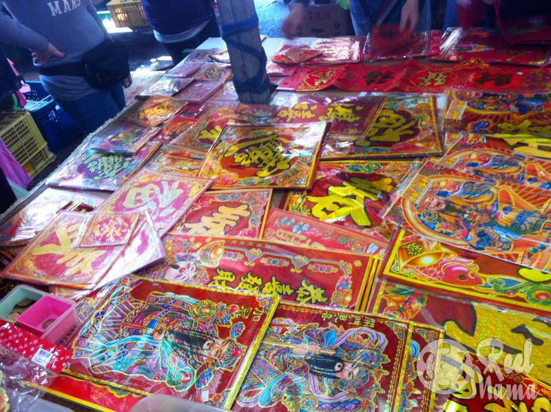 Lunar New Year traditions ~ In our traditional market, lots of vendors sell these paper squares with auspicious words on it.