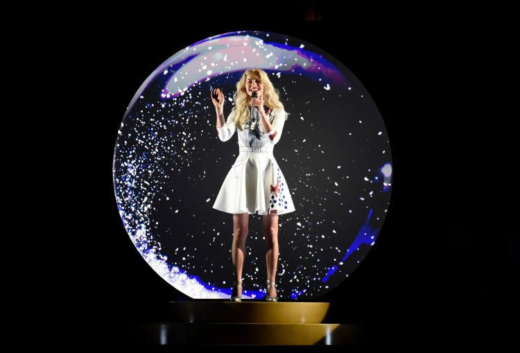 "Julianne Hough sings from a snow globe at Magic Kingdom Park in Lake Buena Vista, Fla., during a taping for ""The Wonderful World of Disney: Magical Holiday Celebration,"" an exciting two-hour ABC special from Walt Disney World Resort and Disneyland Resort. The show premieres Thursday, November 30, 9–11p.m. ET, on The ABC Television Network. (Todd Anderson, photographer)"