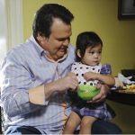 Cameron (Eric Stonestreet) and Lily (Aubrey Anderson-Emmons) in Modern Family