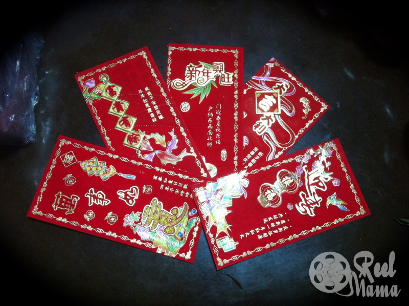 "Lunar New Year tradition in Taiwan: Family members hang out ""lucky money"" — hong bao in red envelopes to elders and children."