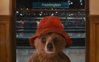 "Paddington bear in the new Paddington movie, seen here at Paddington station where he wears the tag reading, ""Please look after this bear."""