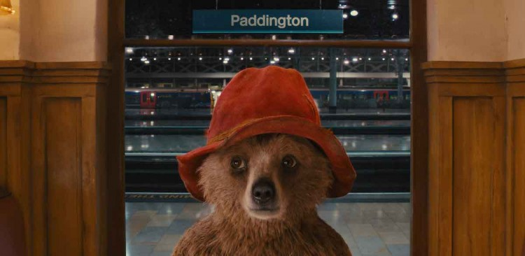 """Paddington bear in the new Paddington movie, seen here at Paddington station where he wears the tag reading, """"Please look after this bear."""""""