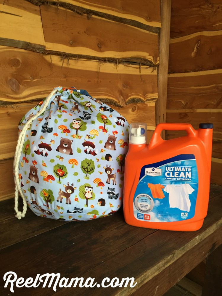 Member's Mark Ultimate Clean Liquid Laundry Cleaner is wonderful for washing baby clothes. Pictured here with the DIY cute baby clothes hamper.