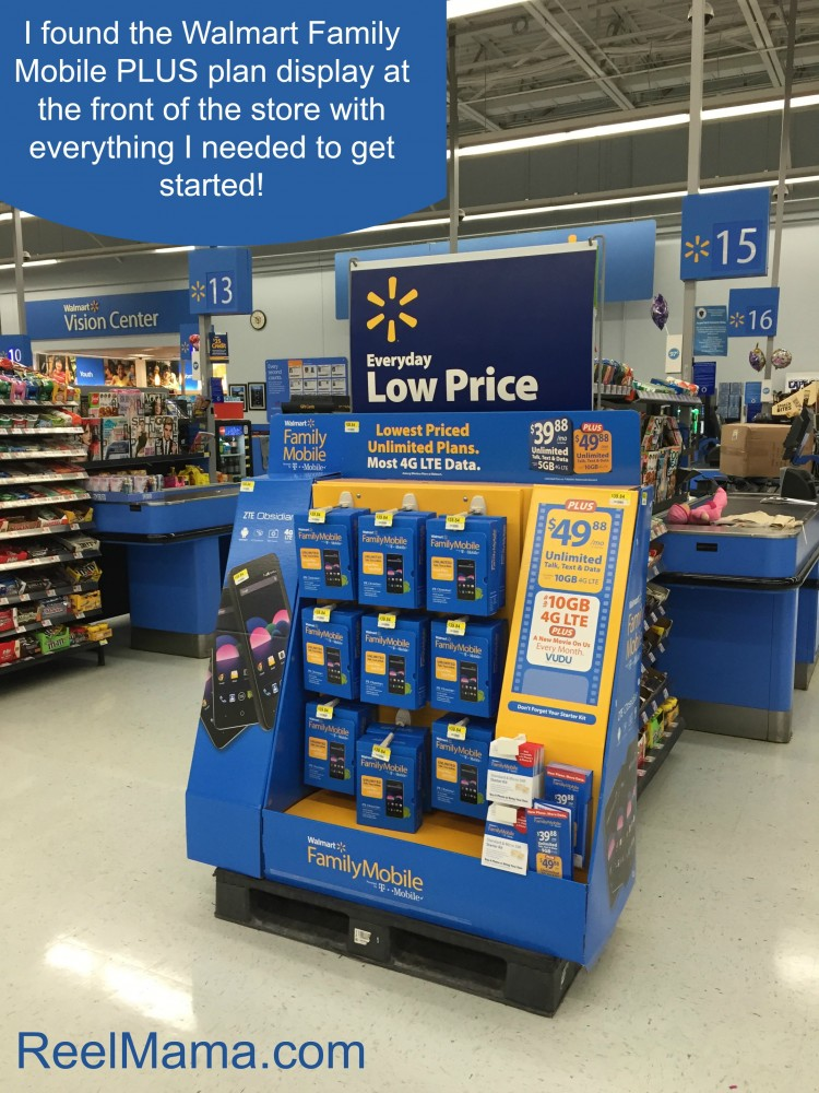 Walmart Family Mobile PLUS plan display at the front of the store