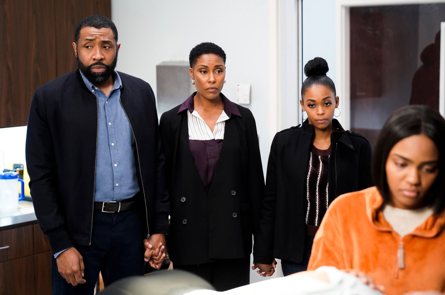 "Black Lightning -- ""The Book of Secrets: Chapter One: Prodigal Son"" -- Image BLK211b_0481b.jpg -- Pictured (L-R): Cress Williams as Jefferson, Christine Adams as Lynn, Nafessa Williams as Anissa and China Anne McClain as Jennifer -- Photo: Jace Downs/The CW -- © 2019 The CW Network, LLC. All rights reserved"