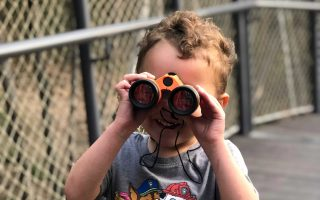 Help your kids be explorers by taking them on an outdoor adventure. Toy binoculars help!