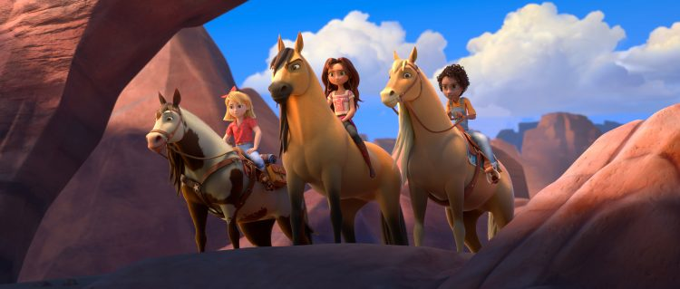 Abigail Stone (Mckenna Grace) riding Boomerang, Lucky Prescott (Isabela Merced) riding Spirit and Pru Granger (Marsai Martin) riding Chica Linda in DreamWorks Animation's Spirit Untamed, directed by Elaine Bogan.